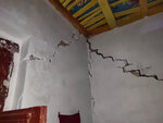 In this photo released by China's Xinhua News Agency, cracks are seen after an earthquake in the walls of a home in Jiashi County of Kashgar prefecture in northwestern China's Xinjiang Uighur Autonomous Region, Monday, Jan. 20, 2020. A strong earthquake has damaged buildings and injured at least one person seriously in China's far west Xinjiang region. (Li Chengxin/Xinhua via AP)