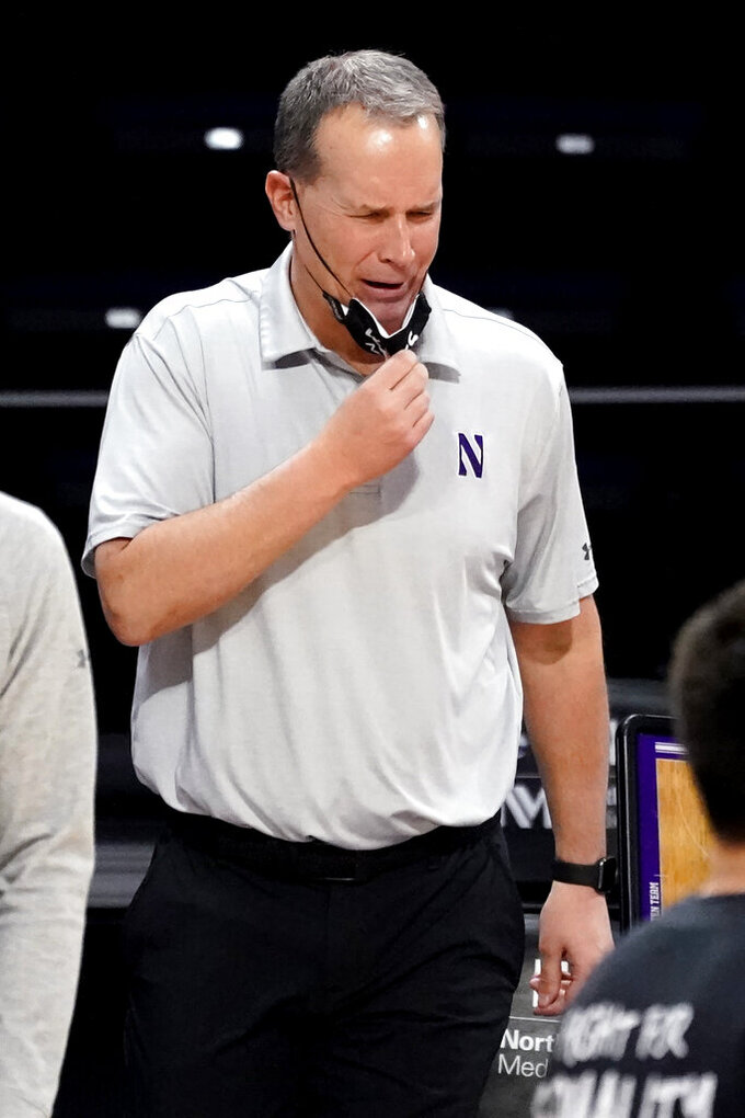 Northwestern head coach Chris Collins reacts as he watches his team during the second half of an NCAA college basketball game against Rutgers in Evanston, Ill., Sunday, Jan. 31, 2021. (AP Photo/Nam Y. Huh)