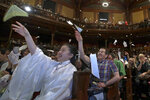 FILE - In this Sept. 12, 2019 file photo, audience members toss paper airplanes at the 29th annual Ig Nobel awards ceremony at Harvard University, in Cambridge, Mass. The spoof prizes for weird and sometimes head-scratching scientific achievement will be presented online in 2021 due to the coronavirus pandemic. (AP Photo/Elise Amendola, File)