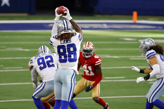 Dallas Cowboys wide receiver CeeDee Lamb (88) reaches up to catch an onside kick as San Francisco 49ers cornerback Emmanuel Moseley (41) looks on in the second half of an NFL football game in Arlington, Texas, Sunday, Dec. 20, 2020. Lamb returned the kick for a touchdown. (AP Photo/Ron Jenkins)