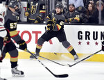 Vegas Golden Knights defenseman Shea Theodore (27) passes the puck against the Chicago Blackhawks during the second period of an NHL hockey game Tuesday, Feb. 13, 2018, in Las Vegas. (AP Photo/David Becker)