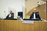 Public prosecutor Ward Ferdinandusse, right, waits for the trial to resume at the high security court building at Schiphol Airport, near Amsterdam, Monday, June 8, 2020, for three Russians and a Ukrainian charged with crimes including murder for their alleged roles in the shooting down of Malaysia Airlines Flight MH17 over eastern Ukraine nearly six years ago. (AP Photo/Robin van Lonkhuijsen, POOL)