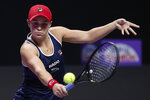 Ashleigh Barty of Australia hits a return shot against Elina Svitolina of Ukraine during the WTA Finals Tennis Tournament at the Shenzhen Bay Sports Center in Shenzhen, China's Guangdong province, Sunday, Nov. 3, 2019. (AP Photo/Andy Wong)