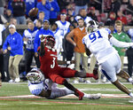 Louisville quarterback Malik Cunningham (3) attempts a pass while being brought down by Kentucky linebacker Josh Allen (41) during the first half of an NCAA college football game in Louisville, Ky., Saturday, Nov. 24, 2018. (AP Photo/Timothy D. Easley)