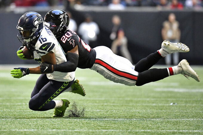 Seattle Seahawks wide receiver Tyler Lockett (16) makes the catch against Atlanta Falcons defensive back Kendall Sheffield (20) during the second half of an NFL football game, Sunday, Oct. 27, 2019, in Atlanta. The Seattle Seahawks won 27-20. (AP Photo/Danny Karnik)