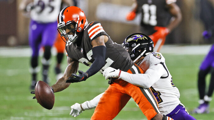 Baltimore Ravens cornerback Marlon Humphrey (44) breaks up a pass intended for Cleveland Browns wide receiver Rashard Higgins (82) during the first half of an NFL football game, Monday, Dec. 14, 2020, in Cleveland. (AP Photo/Ron Schwane)
