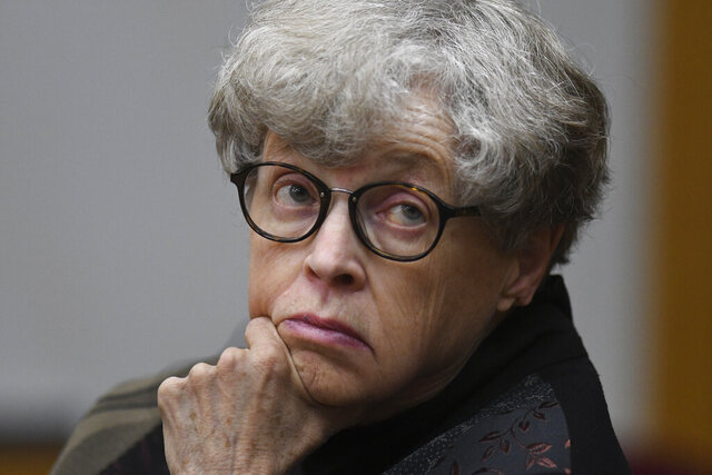 FILE - In this April 9, 2019 file photo, former Michigan State University president Lou Anna Simon appears in court in Charlotte, Mich. A judge has dismissed criminal charges Wednesday, May 13, 2020 against Simon arising from the Larry Nassar sexual assault scandal. Simon was ordered to trial last year on charges that she lied to police about her knowledge of a sexual misconduct complaint against Nassar. Nassar was a campus doctor and now is serving decades in prison.(Matthew Dae Smith/Lansing State Journal via AP, File)