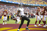 Baltimore Ravens quarterback Tyler Huntley (2) celebrating his touchdown against the Washington Football Team during the first half of a preseason NFL football game, Saturday, Aug. 28, 2021, in Landover, Md. (AP Photo/Nick Wass)