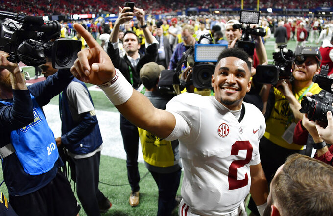 FILE - In this Saturday, Dec. 1, 2018 file photo, Alabama quarterback Jalen Hurts (2) speaks to fans after the Southeastern Conference championship NCAA college football game between Georgia and Alabama, in Atlanta. Alabama won 35-28. Even before Hurts came off the bench to lead Alabama's comeback win over Georgia in the Southeastern Conference championship game, his popularity has only seemed to grow since his role shrank. (AP Photo/John Amis, File)