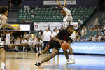 Houston guard DeJon Jarreau (3) dribbles past Georgia Tech forward Khalid Moore (12) during the second half of an NCAA college basketball game Monday, Dec. 23, 2019, in Honolulu. (AP Photo/Marco Garcia)