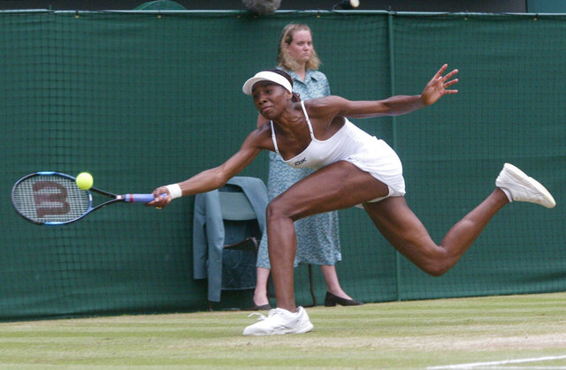 FILE - In this July 6, 2002, file photo, Venus Williams stretches for a shot from her sister Serena during the women's singles final on the Centre Court at Wimbledon. Serena won the match 7-6 (7-4), 6-3 to win the championship. (AP Photo/Dave Caulkin, File)