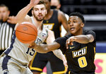 VCU's Jamir Watkins passes the ball as Penn State's Trent Buttrickduring an NCAA college basketball game Wednesday, Dec. 2, 2020, in State College, Pa. (Abby Drey/Centre Daily Times via AP)