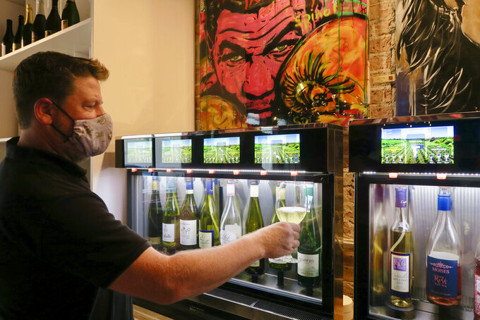 Stained Glass Wine House is a wine bar in downtown Gretna with a self-serve approach through computerized wine dispensers. (Ian McNulty/The Times-Picayune/The New Orleans Advocate via AP)