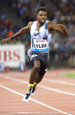 FILE - In this Aug. 29, 2019, file photo, Noah Lyles, of the United States, competes in the men's 100m race during the Weltklasse IAAF Diamond League international athletics meet in Zurich, Switzerland. The most promising signal that track and field remains in good hands even after Usain Bolt's retirement comes from a 22-year-old American named Noah Lyles who appreciates the Jamaican superstar more for what he did after his races than during them.  When Lyles spends time studying Bolt on video, he looks not at the lanky speedster's form in between the lines, but at the dancing, rollicking post-race celebrations Bolt concocted to make his sport can't-miss viewing whenever he was on the track. (Jean-Christophe Bott/Keystone via AP, File)