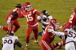 Kansas City Chiefs quarterback Patrick Mahomes (15) throws under pressure against the Denver Broncos in the second half of an NFL football game in Kansas City, Mo., Sunday, Dec. 6, 2020. (AP Photo/Charlie Riedel)