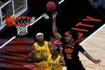 Oklahoma State's Matthew-Alexander Moncrieffe (12) shoots over Baylor's Mark Vital (11) and Flo Thamba (0) during the first half of an NCAA college basketball game in the semifinals of the Big 12 tournament in Kansas City, Mo., Friday, March 12, 2021. (AP Photo/Charlie Riedel)