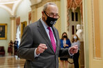 Senate Majority Leader Chuck Schumer of N.Y. walks off the Senate floor and pumps his fists as the Senate approves a $1 trillion bipartisan cornerstone of the Biden agenda to the House, on Capitol Hill in Washington, Tuesday, Aug. 10, 2021. (AP Photo/Andrew Harnik)