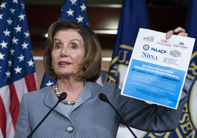 Speaker of the House Nancy Pelosi, D-Calif., displays an advocacy ad that criticizes the tobacco and vaping industry for allegedly targeting young African-Americans, during a news conference on Capitol Hill in Washington, Thursday, Feb. 27, 2020. The House is voting on a measure to reverse the tobacco epidemic among young people. (AP Photo/J. Scott Applewhite)