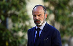FILE - In this May 20, 2020 file photo, French Prime Minister Edouard Philippe arrives for a meeting in Paris.  A special French court has ordered an investigation of three current or former government ministers over their alleged handling of the coronavirus crisis. The investigation stems from complaints filed in the Court of Justice of the Republic targeting former Prime Minister Edouard Philippe, who resigned Friday July 3, 2020.  (Thomas Coex, Pool FILE via AP)