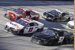 Racers Denny Hamlin (11), Kyle Busch (18), Aric Almirola (10) and Joey Gase (51) speed through a turn during a NASCAR Cup Series auto race at Bristol Motor Speedway Sunday, May 31, 2020, in Bristol, Tenn. (AP Photo/Mark Humphrey)