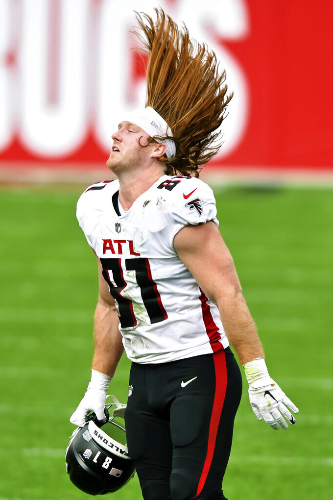 Atlanta Falcons tight end Hayden Hurst (81) flips his hair after a play during the second half of an NFL football game against the Tampa Bay Buccaneers Sunday, Jan. 3, 2021, in Tampa, Fla. (AP Photo/Jason Behnken)
