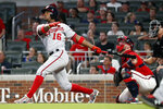 Washington Nationals' Victor Robles (16) follows through on a two-run home run as Atlanta Braves catcher Tyler Flowers, second from right, looks on in the ninth inning of a baseball game Friday, July 19, 2019, in Atlanta. (AP Photo/John Bazemore)
