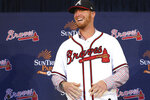 New Atlanta Braves left-handed pitcher Will Smith smiles during a baseball introductory press conference at SunTrust Park in Atlanta, Tuesday, Nov. 19, 2019. (Curtis Compton/Atlanta Journal-Constitution via AP)
