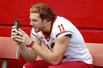 FILE - In this Aug. 7, 2018, file photo, Iowa State tight end Chase Allen takes a photo with his cell phone during Iowa State's annual NCAA college football media day in Ames, Iowa. While autograph-signing and public appearances have been traditional ways athletes could make extra money, opportunities now are tied to social media posts where athletes could in the future be paid for posting sponsored content. (AP Photo/Charlie Neibergall, File)