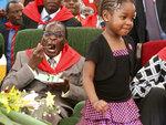FILE - In this Saturday, Feb. 28, 2009, file photo, Zimbabwe's President Robert Mugabe eats birthday cake during his 85th birthday celebrations in Chinhoyi, Zimbabwe. Mugabe, the longtime leader of Zimbabwe who was forced to resign in 2017 after a military takeover, has died at 95. (AP Photo/Tsvangirayi Mukwazhi, file)