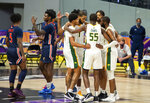 Norfolk State players huddle during a time-out in the second half of an NCAA college basketball game against Morgan State in the championship of the Mid-Eastern Athletic Conference tournament at the Scope Arena on Saturday, March 13, 2021, in Norfolk, Va. (AP Photo/Mike Caudill)