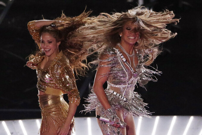 Singers Shakira, left, and Jennifer Lopez perform during the halftime show at the NFL Super Bowl 54 football game between the San Francisco 49ers and Kansas City Chiefs', Sunday, Feb. 2, 2020, in Miami Gardens, Fla. (AP Photo/Charlie Riedel)