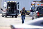 Law enforcement respond to an active shooter situation at the Bunn-O-Matic warehouse on Stevenson Drive, Friday, June 26, 2020, in Springfield, Ill. Police say officers are searching for a gunman at a warehouse in the Illinois state capital after at least one person was shot and wounded. (Justin L. Fowler/The State Journal-Register via AP)