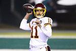 Washington Football Team's Alex Smith plays during the first half of an NFL football game against the Philadelphia Eagles, Sunday, Jan. 3, 2021, in Philadelphia. (AP Photo/Derik Hamilton)