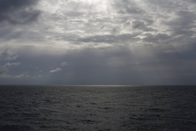 FILE -In this Sunday, Sept. 8, 2019 file photo the sun pierces the clouds over international waters north of Libya in the Mediterranean Sea.   A rubber dinghy packed with 91 migrants that set out from Libyan shores in hopes of reaching Europe has apparently gone missing in the Mediterranean, the U.N. refugee agency said Thursday, Feb. 20, 2020. The inflatable boat carrying mostly African migrants departed from al-Qarbouli, 50 kilometers (30 miles) east of the capital Tripoli on Feb. 8, said Osman Haroun, whose cousin was on board. He hasn't heard from the 27-year-old Mohamed Idris, or his 10 other friends also on the boat, since. (AP Photo/Renata Brito, File)