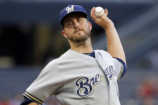 FILE - In this Aug. 7, 2019, file photo, Milwaukee Brewers starting pitcher Drew Pomeranz delivers during the first inning of the team's baseball game against the Pittsburgh Pirates in Pittsburgh. Pomeranz moved to the San Diego Padres for the 2020 season. (AP Photo/Gene J. Puskar, File)
