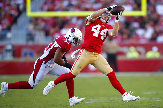 San Francisco 49ers fullback Kyle Juszczyk (44) catches a pass in front of Arizona Cardinals middle linebacker Jordan Hicks (58) during the first half of an NFL football game in Santa Clara, Calif., Sunday, Nov. 17, 2019. (AP Photo/John Hefti)