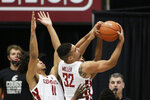Washington State forward Tony Miller (32) grabs a rebound next to forward DJ Rodman (11) during the second half of the team's NCAA college basketball game against Utah in Pullman, Wash., Thursday, Jan. 21, 2021. (AP Photo/Young Kwak)