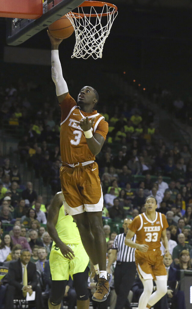 Texas guard Courtney Ramey (3) scores against Baylor during the first half of a NCAA college basketball game Wednesday, Feb. 27, 2019, in Waco, Texas. (Jerry Larson/Waco Tribune Herald via AP)
