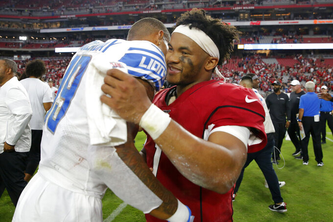 Arizona Cardinals quarterback Kyler Murray, right, greets Detroit Lions wide receiver Kenny Golladay after an NFL football game, Sunday, Sept. 8, 2019, in Glendale, Ariz. The Lions and Cardinals played to a 27-27 tie on overtime. (AP Photo/Rick Scuteri)