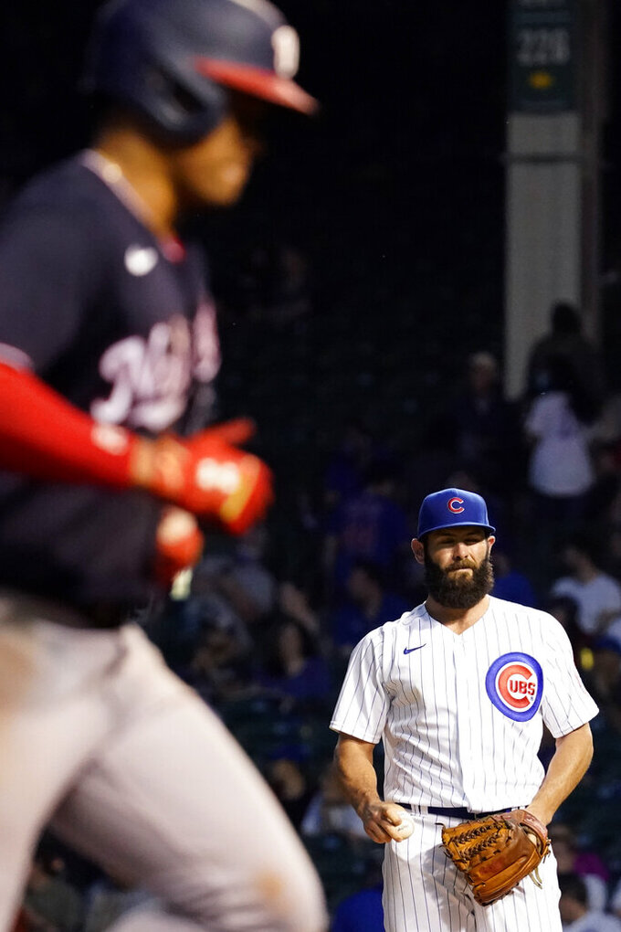 Chicago Cubs starting pitcher Jake Arrieta, right, reacts as Washington Nationals' Juan Soto rounds the bases after hitting a solo home run during the fifth inning of a baseball game in Chicago, Wednesday, May 19, 2021. (AP Photo/Nam Y. Huh)