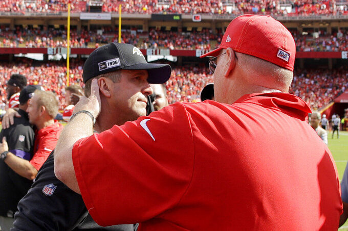 Kansas City Chiefs head coach Andy Reid, right, and Baltimore Ravens head coach John Harbaugh greet each other after their NFL football game Sunday, Sept. 22, 2019, in Kansas City, Mo. (AP Photo/Charlie Riedel)