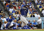 San Diego Padres' Eric Hosmer drives in a run with a double against the Los Angeles Dodgers during the third inning of a baseball game Friday, July 5, 2019, in Los Angeles. (AP Photo/Marcio Jose Sanchez)