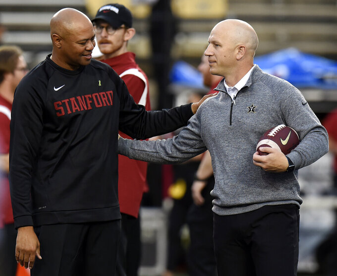 Stanford head coach David Shaw, left, talks with Vanderbilt head coach Clark Lea before an NCAA college football game Saturday, Sept. 18, 2021, in Nashville, Tenn. (AP Photo/Mark Zaleski)