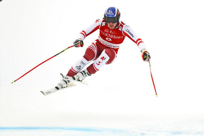 Austria's Matthias Mayer competes during an alpine ski, men's World Cup Super-G, in Kitzbuehel, Austria, Monday, Jan. 25, 2021. (AP Photo/Marco Trovati)