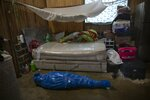 Corazona Pena's body lies wrapped in plastic by a Peruvian COVID-19 specialized government team in Pucallpa, in Peru's Ucayali region, Tuesday, Sept. 29, 2020. The global death toll from COVID-19 has topped 2 million. It took eight months to hit 1 million lives lost. It took less than four months after that to reach the next million. (AP Photo/Rodrigo Abd)