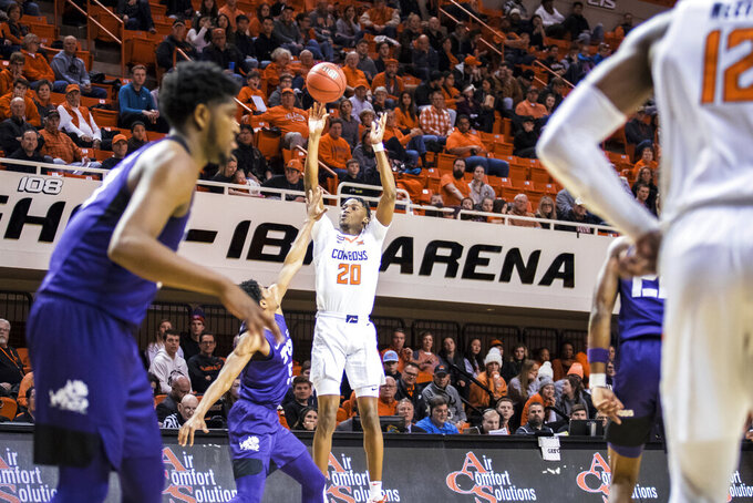 Oklahoma State guard Keylan Boone shoots a 3-pointer against TCU during an NCAA college basketball game Wednesday, Feb. 5, 2020, in Stillwater, Okla. (Devin Lawrence/Tulsa World via AP)