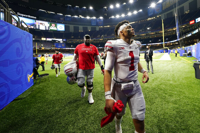 Ohio State quarterback Justin Fields leaves the field after the team's win against Clemson in the Sugar Bowl NCAA college football game Friday, Jan. 1, 2021, in New Orleans. Ohio State won 49-28. (AP Photo/Gerald Herbert)
