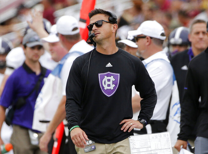 FILE - In this Sept. 8, 2018, file photo, Holy Cross head coach Bob Chesney reacts on the sideline during the first half of a college football game against Boston College in Boston. Holy Cross plays at Navy on Saturday. (AP Photo/Mary Schwalm, File)