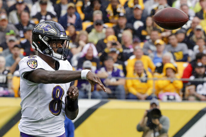 Baltimore Ravens quarterback Lamar Jackson (8) passes against the Pittsburgh Steelers in the first half of an NFL football game, Sunday, Oct. 6, 2019, in Pittsburgh. (AP Photo/Don Wright)