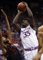 Kansas center Udoka Azubuike (35) shoots over Stanford forward Trevor Stanback (33) during the first half of an NCAA college basketball game in Lawrence, Kan., Saturday, Dec. 1, 2018. (AP Photo/Orlin Wagner)